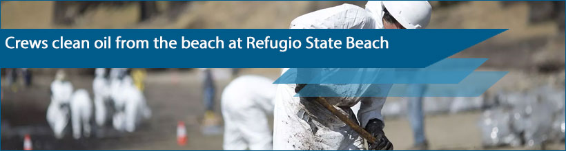 Crews clean oil from the beach at Refugio State Beach north of Goleta, Calif